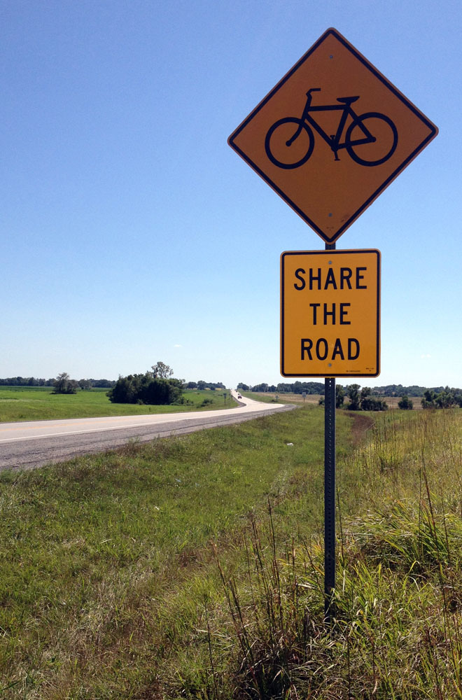 Signs like this will remind drivers to look out for cyclists who have the same right to use roads as motor vehicles.